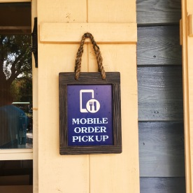 Mobile Order Pick Up sign at Harbour Galley in Disneyland